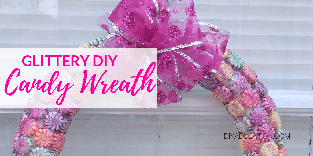Close Up of Candy Wreath Hanging on Door with text overlay - DIY Glittery Candy Wreath