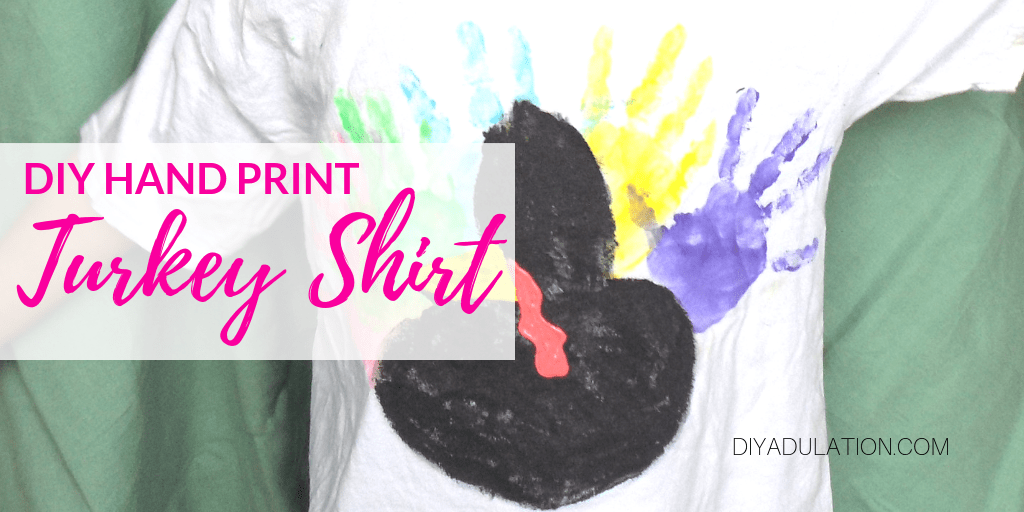 Close up of Hand Print Turkey Shirt with text overlay - DIY Hand Print Turkey Shirt
