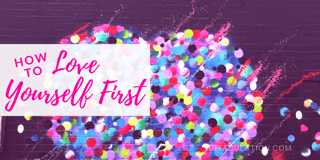 Polka Dot Heart on Brick Wall with text overlay - How to Love Yourself First