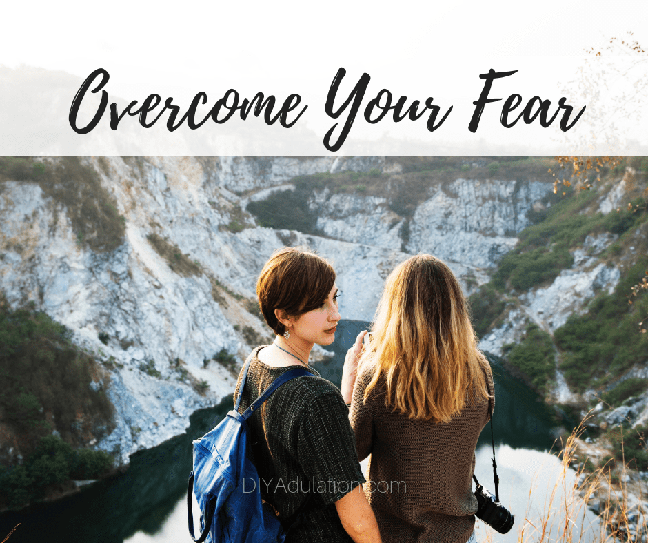 Two Women Standing at a Rock Cliff with text overlay - Overcome Your Fear