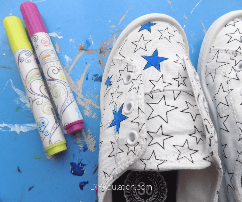 White Canvas Shoes with stars colored blue