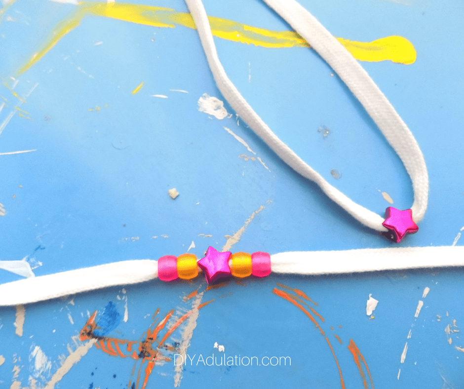 White Shoe Laces with pink star beads and translucent pony beads