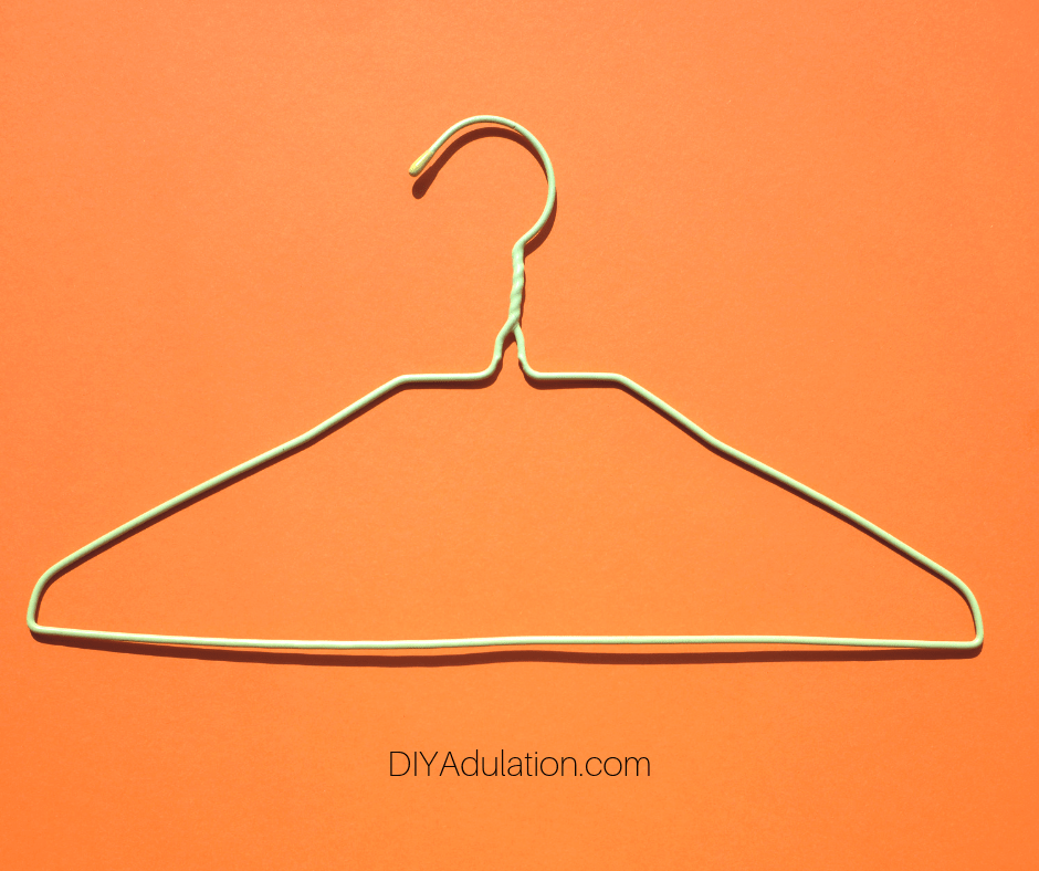 Wire Hanger on Orange Background