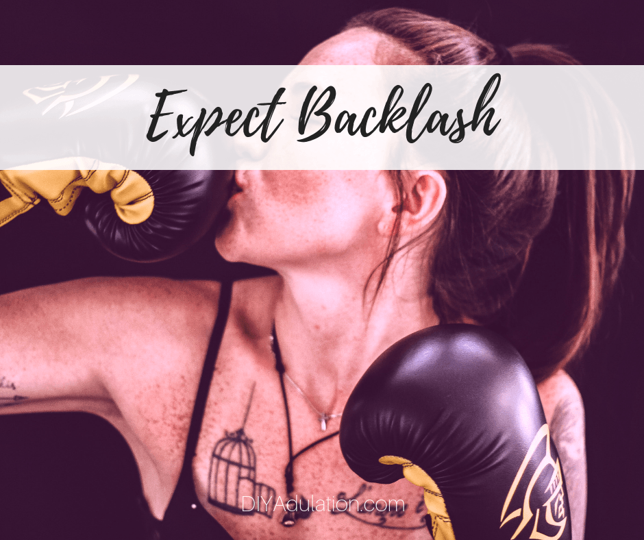 Woman kissing boxing glove with text overlay - Expect Backlash