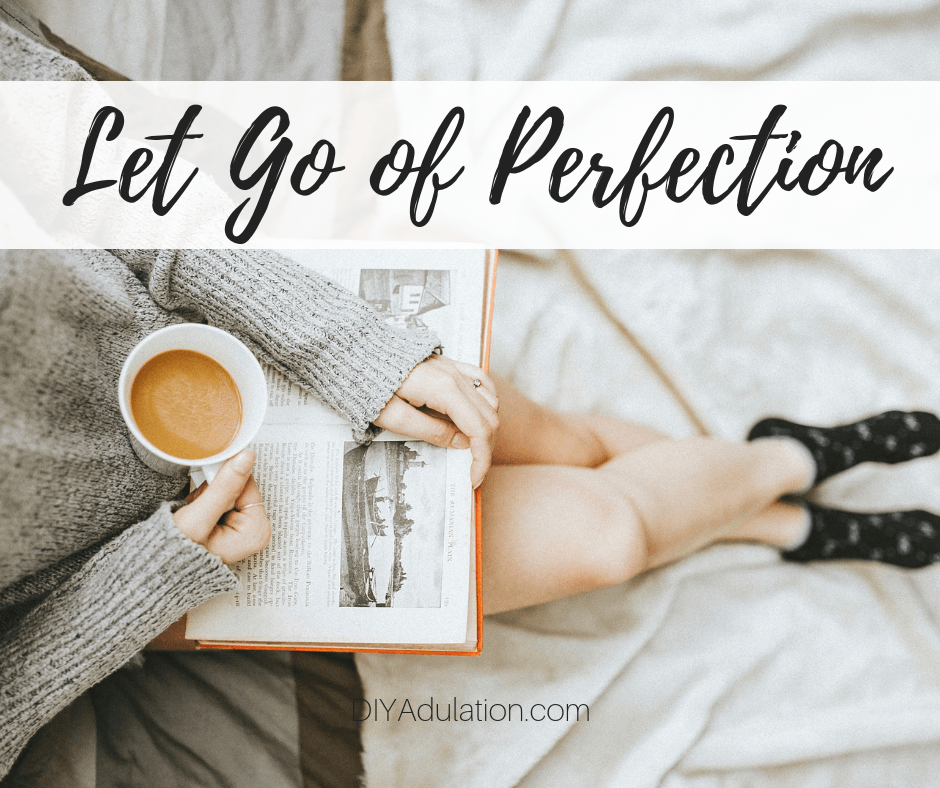 Woman sitting with coffee reading a book with text overlay - Let Go of Perfection