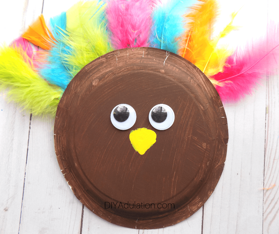 Yellow Beak Painted on Brown Paper Plate