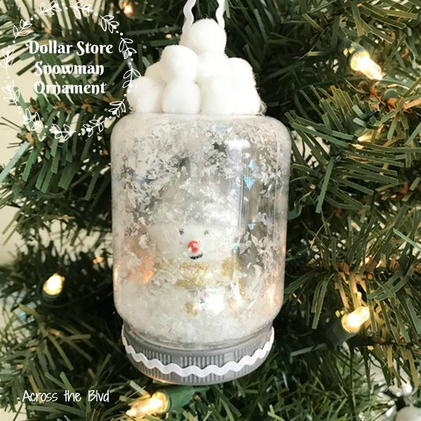 Snow Globe snowman ornament hanging on Christmas Tree