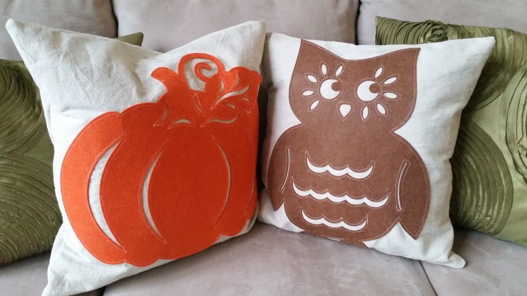 Pumpkin and owl pillows on couch