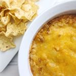 Close up of bowl of bean dip and chips