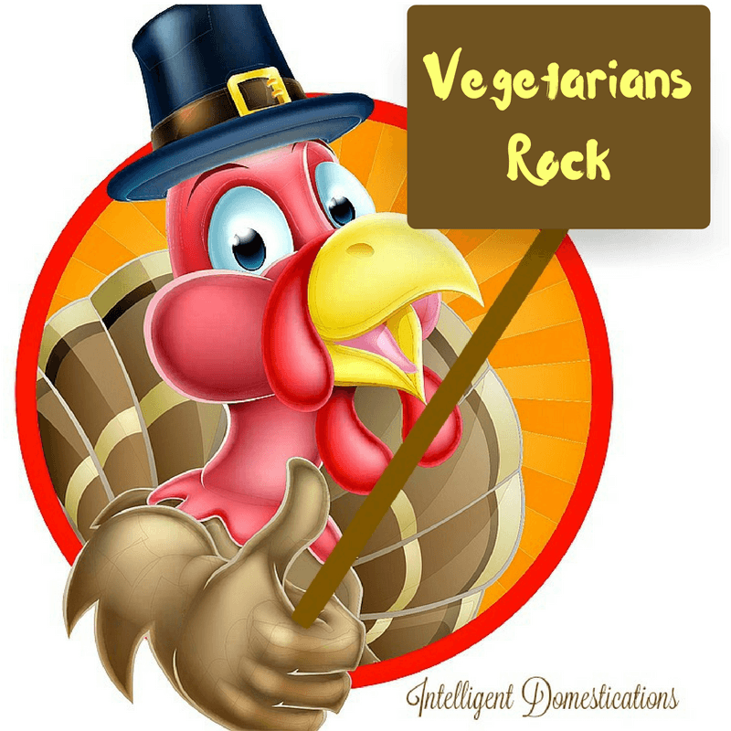 "Cartoon turkey holding a sign saying ""Vegetarians Rock"""