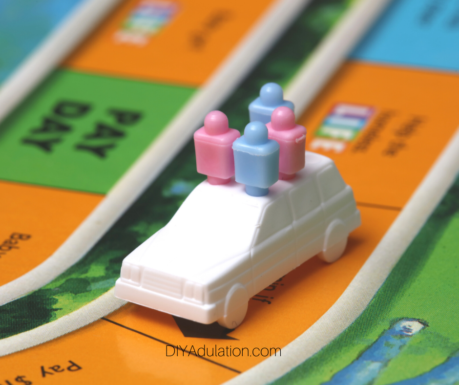 Close Up of Car with Pegs in it on Game Board