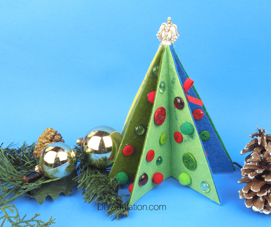 Decorated Felt Christmas Tree next to Greenery
