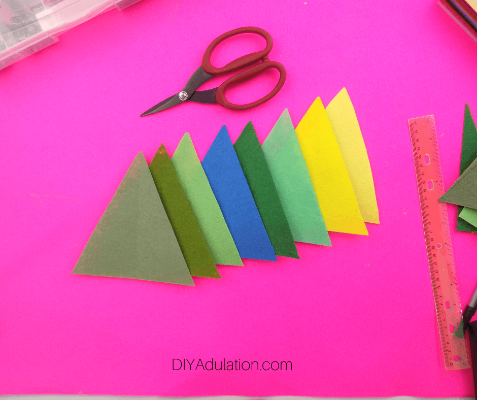 Line of Felt Triangles next to Scissors