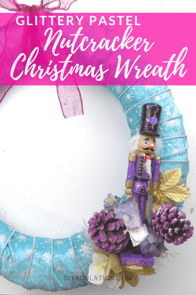 Nutcracker and Floral Elements on Wreath with text overlay - Glittery Pastel Nutcracker Christmas Wreath