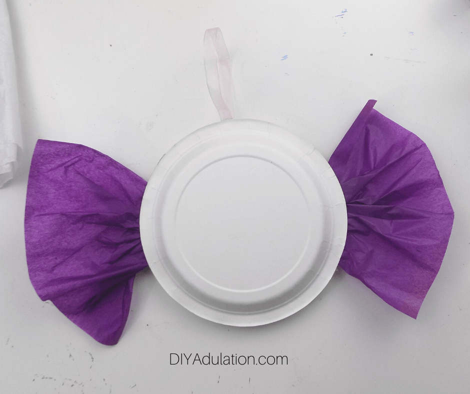 Paper Plates Glued Together with Tissue Paper and Ribbon Hanger