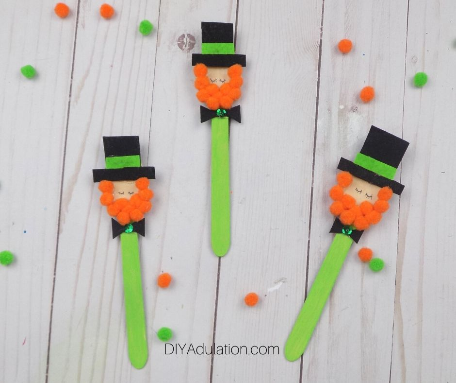 Adorable Leprechaun Craft Spoons next to Pompoms - DIY Adulation