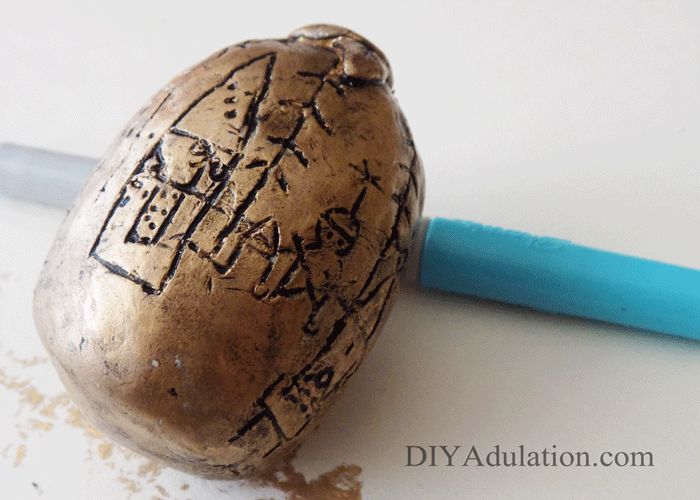 Close up of black paint on carved egg