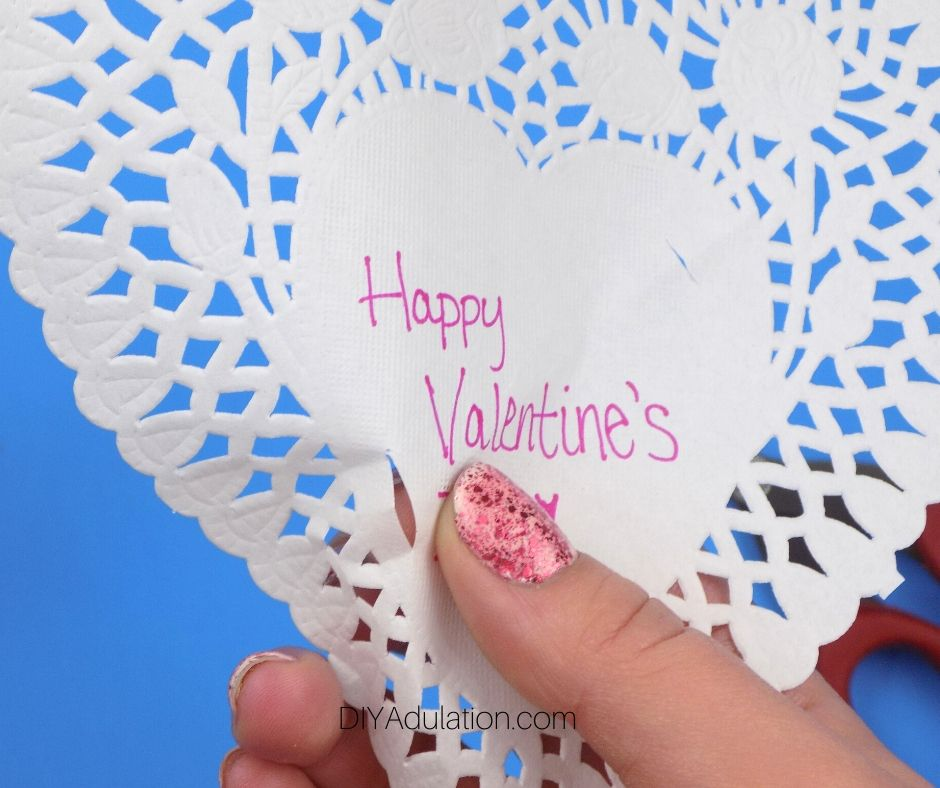Close Up of Slit Cut in Paper Heart Doily - DIY Adulation