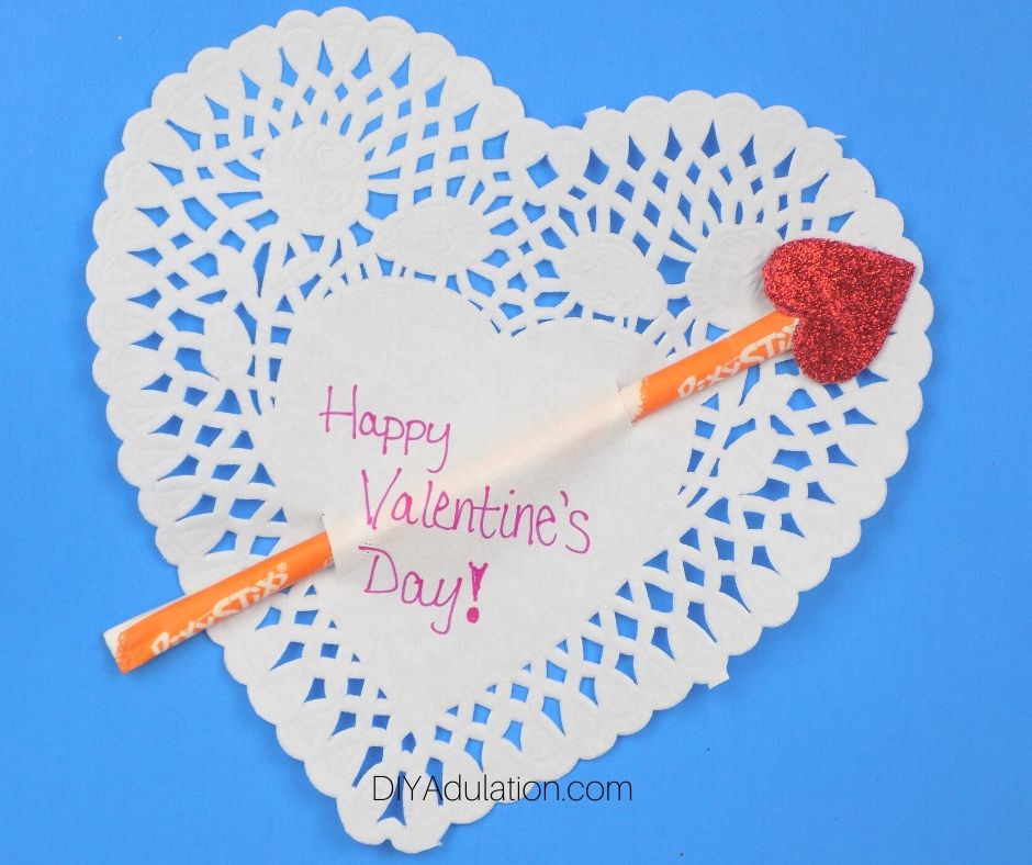 Glitter Heart on End of Pixie Stix in Paper Heart Doily - DIY Adulation