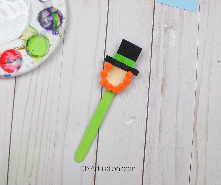 Orange Pompoms Glued to Painted Spoon - DIY Adulation