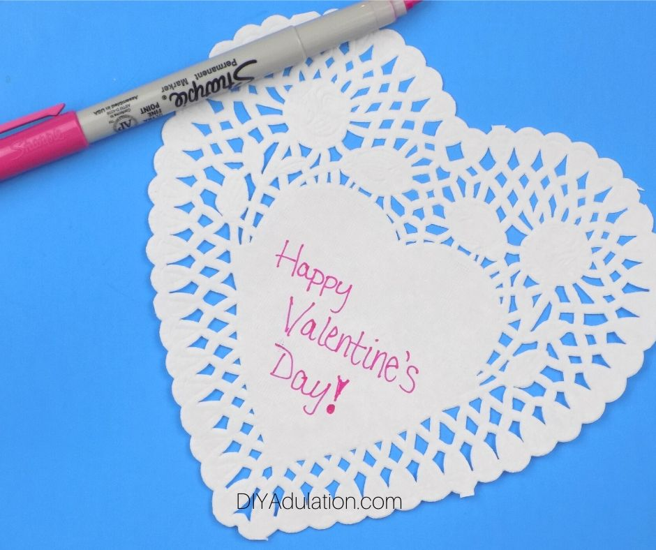 Paper Heart Doily with Happy Valentines Day Written on It - DIY Adulation