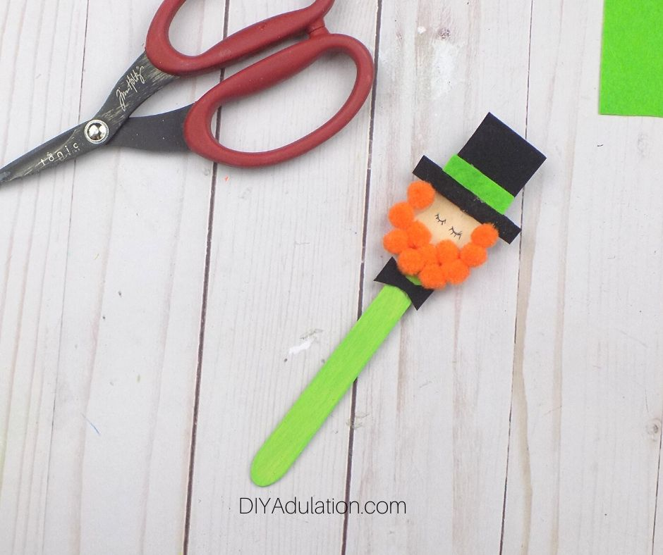 Small Black Felt Bow Tie glued Under Beard on Leprechaun Craft Spoon - DIY Adulation