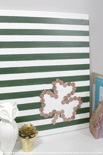 Green and white striped canvas with a shamrock made of pennies